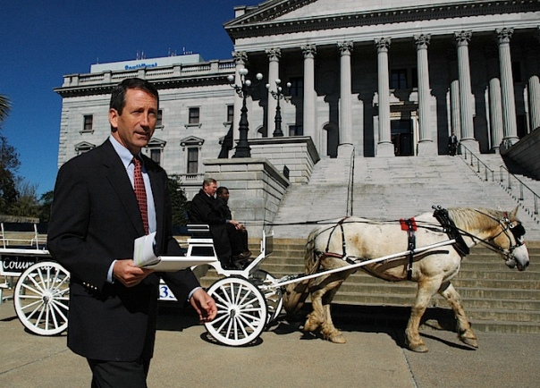 Mark Sanford (R) S.C. shows off the souvenir he bought for his wife while in Argentina